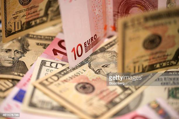 US ten dollar bills and ten euro banknotes are arranged for a photograph inside a Travelex store operated by Travelex Holdings Ltd in London UK on...