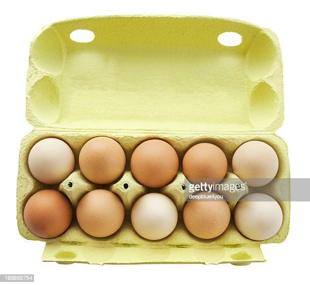 ten eggs in a open yellow box upper view isolated