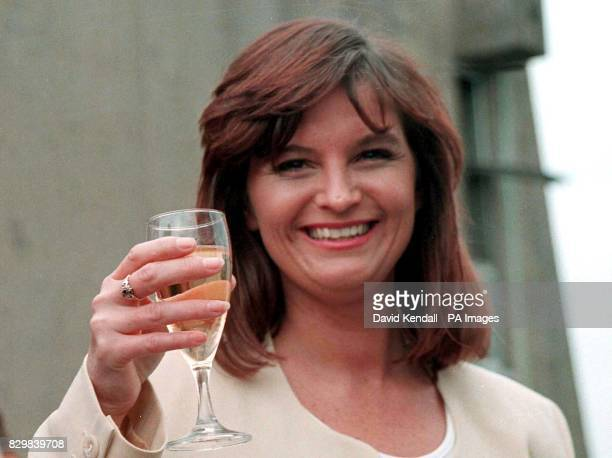 Ten million pound lottery winner Jackie Greene raises a glass of Champagne to toast her new found wealth at a Manchester Hotel