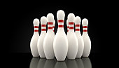 Ten pin bowling pins on black background