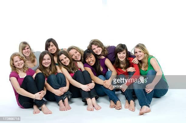 ten smiling teenage girls on the floor