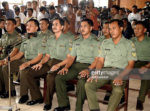 Ten soldiers line up in the court room during the first trial on the massacre of Muslim protestors in Jakarta's Tanjung Priok harbour area 19 years...