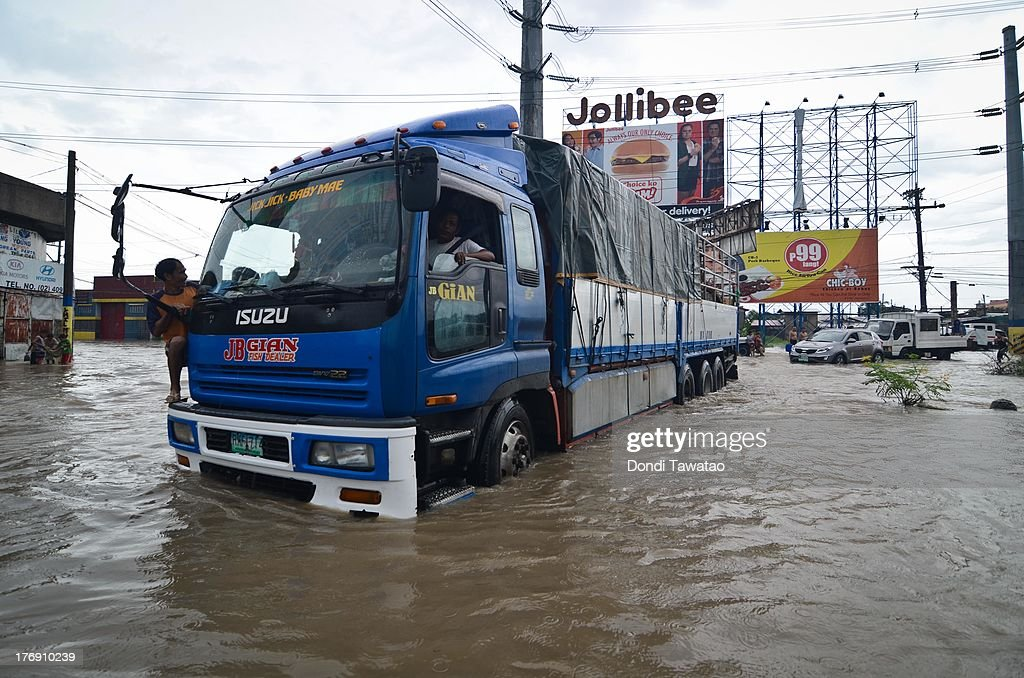 A ten wheeler truck passes through floodwaters that inundated parts of Las Pinas on August 19, 2013 in Las Pinas City south of Manila, Philippines. Tropical storm Trami which was enhanced by monsoon rains swept overnight through the southern metropolitan cities of Manila and leaving huge parts of four provinces underwater forcing residents to evacuate their homes and seek shelter in evacuation centers. At least three fatalities were recorded with thousands more still needing to be rescued.