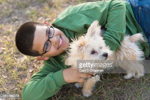 Ten year old boy with a Morkie breed pet dog : Stock Photo
