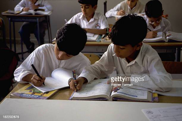Ten year old boys in a classroom Abu Dhabi They are among almost half a million students currently being educated in the schools colleges and...