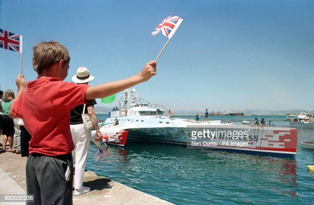 Ten year old expat Oliver Durnall welcomes the Cable and Wireless Adventurer into the Gibraltan docks today at the end of the boat's world record...