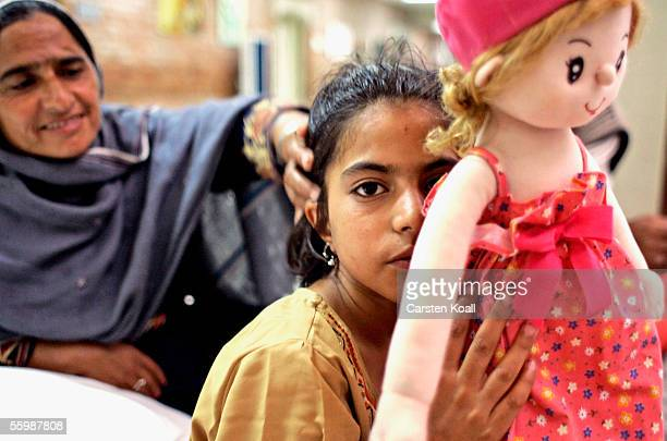 Ten year old female earthquake survivor Aqsabibiholds a toy doll in the Pakistan Institute of Medical Science Hospital on October 23 2005 in...