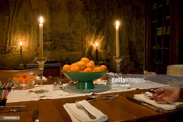 Ten year old girl placing a fork on dining table just before a family Christmas dinner