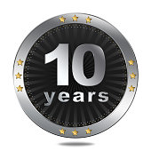 10 years anniversary silver button with gold stars.