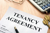 Tenancy agreement and keys from home in a real estate agency.