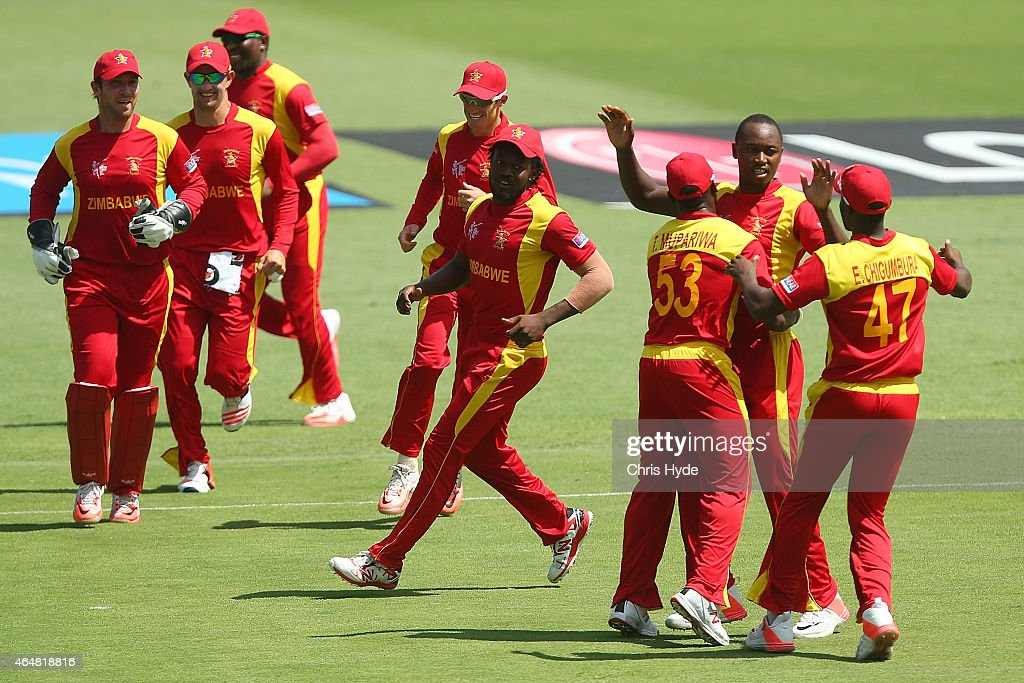Tendai Chatara of Zimbabwe celebrates with team mates after dismissing Nasir Jamshed during the 2015 ICC Cricket World Cup match between Pakistan and...