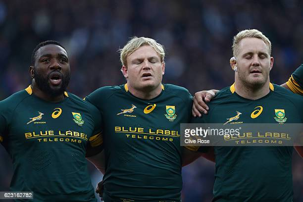 Tendai Mtawarira Adriaan Struass and Vincent Koch of South Africa sing the national anthem prior to kickoff during the Old Mutual Wealth Series match...