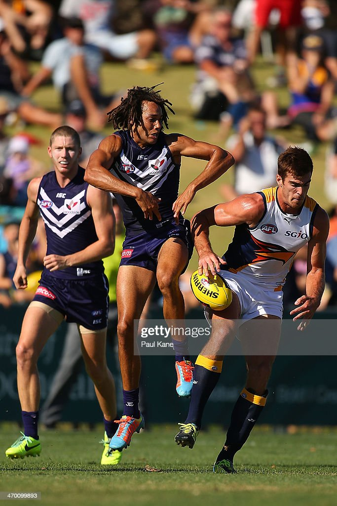 Tendai Mzungu of the Dockers and Scott Lycett of the Eagles contest for the ball during the round two NAB Challenge Cup AFL match between the Fremantle Dockers and the West Coast Eagles at Arena Joondalup on February 18, 2014 in Perth, Australia.