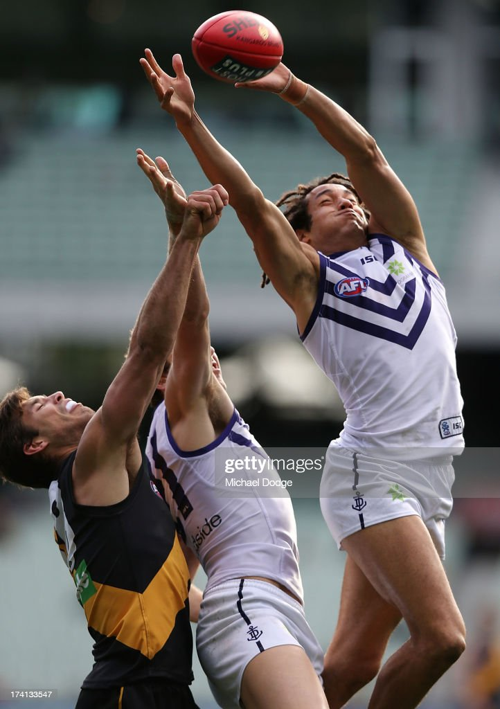 Tendai Mzungu of the Dockers marks the ball during the round 17 AFL match between the Richmond Tigers and the Fremantle Dockers at Melbourne Cricket Ground on July 21, 2013 in Melbourne, Australia.
