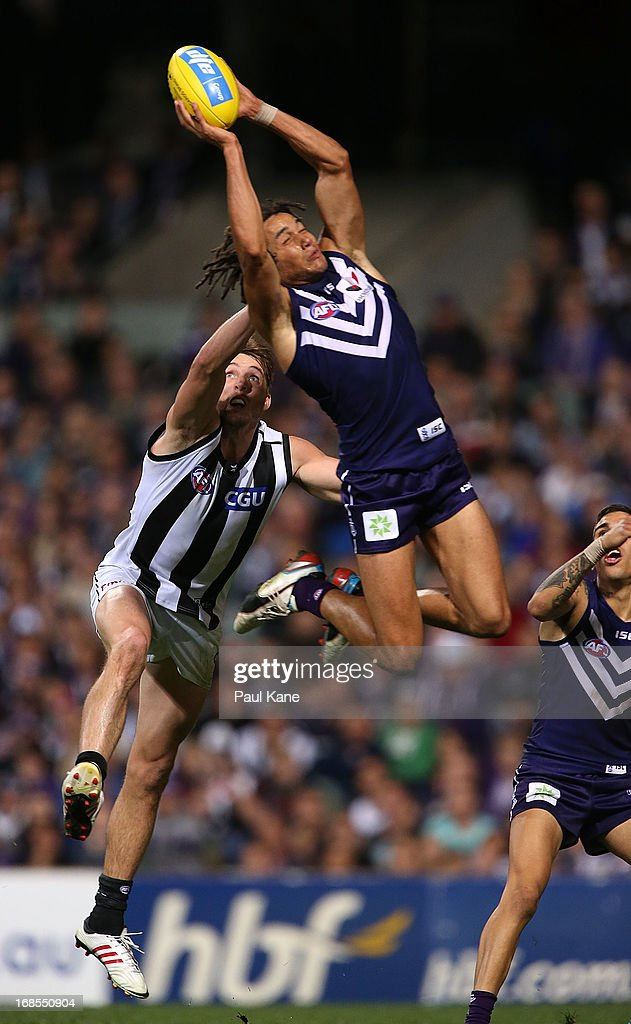 Tendai Mzungu of the Dockers marks the ball during the round seven AFL match between the Fremantle Dockers and the Collingwood Magpies at Patersons Stadium on May 11, 2013 in Perth, Australia.