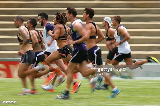Tendai Mzungu of the Dockers runs during a Fremantle Dockers AFL preseason training session at Fremantle Oval on December 1 2014 in Fremantle...