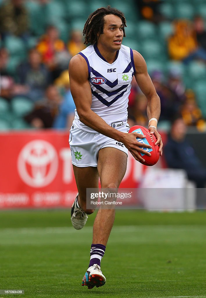 Tendai Mzungu of the Dockers runs with the ball during the round four AFL match between the Hawthorn Hawks and the Fremantle Dockers at Aurora Stadium on April 20, 2013 in Launceston, Australia.