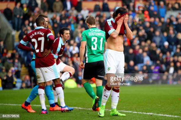 Tendayi Darikwa of Burnley and George Boyd of Burnley are dejected are Lincoln City score during The Emirates FA Cup Fifth Round match between...