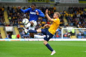 Tendayi Darikwa of Chesterfield challenges for the ball with Alfie Potter of Oxford during the Sky Bet League Two match between Oxford United and...