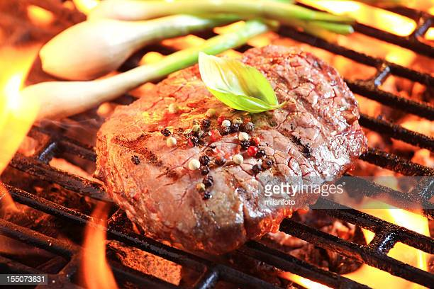 Tender beef steak on a barbecue grill
