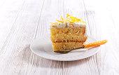 Tender lemon cake with candid lemon, sliced on plate