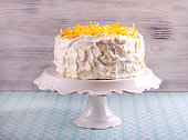Tender lemon cake with candid lemon on stand plate