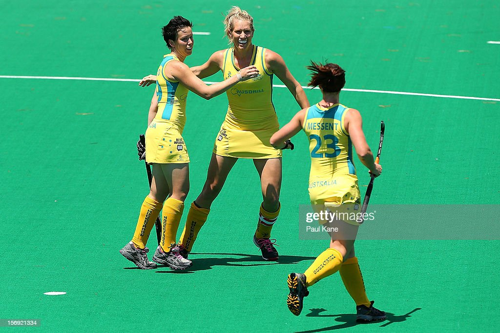 Teneal Attard and Jodie Schulz of the Hockeyroos celebrate a goal in the gold medal match between the Australian Hockeyroos and the Australian Jillaroos during day four of the 2012 International Super Series at Perth Hockey Stadium on November 25, 2012 in Perth, Australia.