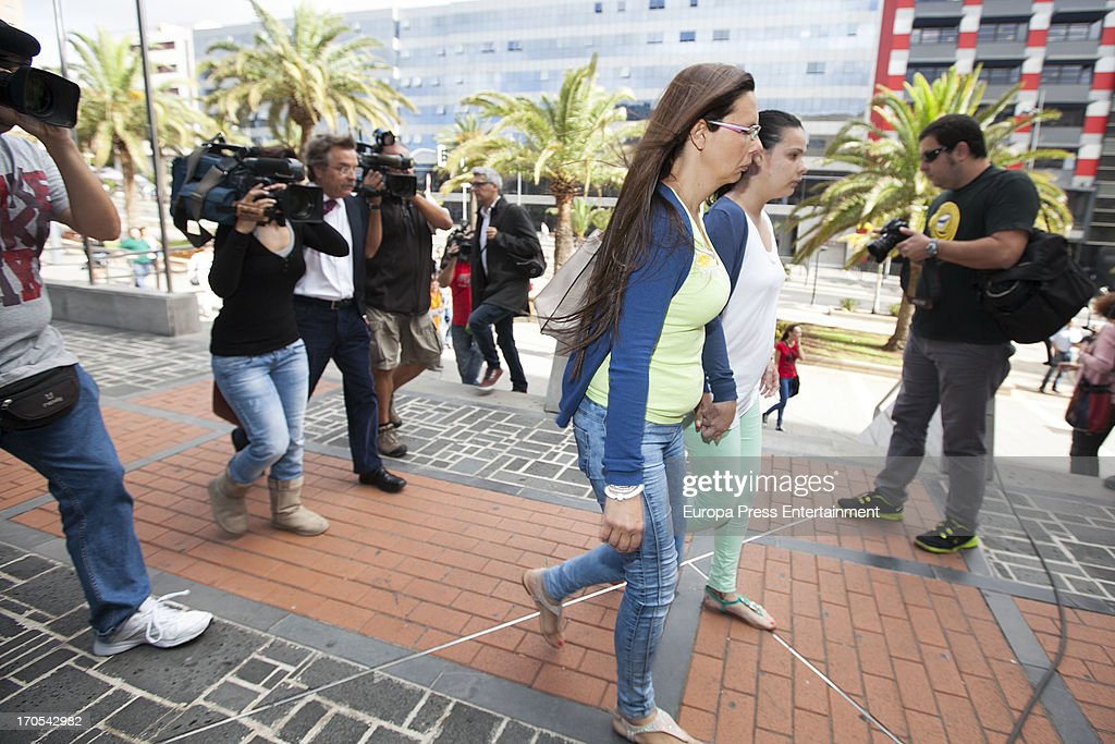 Tenerife Carnival Queen Saida Prieto (R) with her mother attends court on June 13, 2013 in Santa Cruz de Tenerife, Spain. The 25 years-old girl, aspiring as carnival Queen, was severely burned last February after fireworks of another Queen's dress burnt her costume during Carnival Parade.