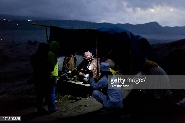A tenggerese shaman praying for an worshipper at the foot of Mount Bromo during the Yadnya Kasada Festival at crater of Mount Bromo on July 24 2013...