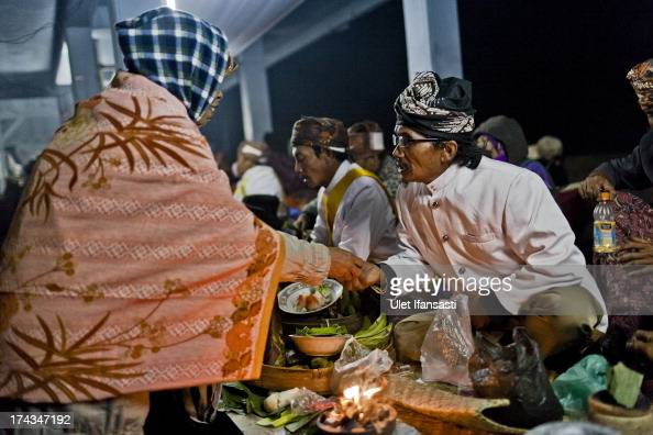 A tenggerese shaman praying for an worshipper before going to Mount Bromo during the Yadnya Kasada Festival at crater of Mount Bromo on July 24 2013...