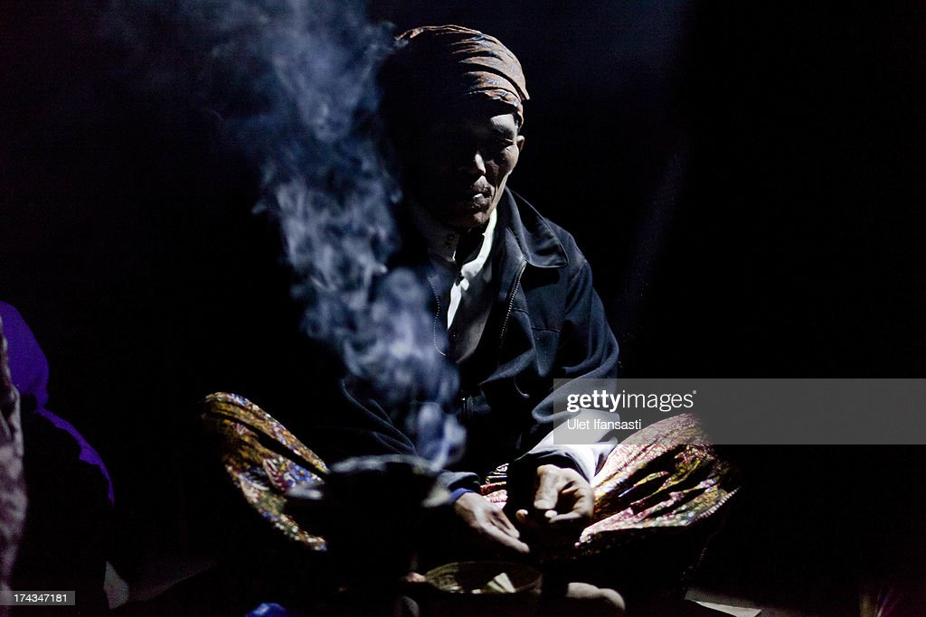 Tenggerese shaman prays during the Yadnya Kasada Festival at crater of Mount Bromo on July 24 2013 in Probolinggo East Java Indonesia The festival is...