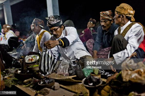 Tenggerese shamans prays at the Temple during the Yadnya Kasada Festival at crater of Mount Bromo on July 24 2013 in Probolinggo East Java Indonesia...