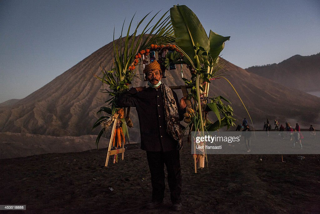Tenggerese worshipper carries vegetables for an offerings during the Yadnya Kasada Festival at crater of Mount Bromo on August 12, 2014 in Probolinggo, East Java, Indonesia. The festival is the main festival of the Tenggerese people and lasts about a month. On the fourteenth day, the Tenggerese make the journey to Mount Bromo to make offerings of rice, fruits, vegetables, flowers and livestock to the mountain gods by throwing them into the volcano's caldera. The origin of the festival lies in the 15th century when a princess named Roro Anteng started the principality of Tengger with her husband Joko Seger, and the childless couple asked the mountain Gods for help in bearing children. The legend says the Gods granted them 24 children but on the provision that the 25th must be tossed into the volcano in sacrifice. The 25th child, Kesuma, was finally sacrificed in this way after initial refusal, and the tradition of throwing sacrifices into the caldera to appease the mountain Gods continues today.