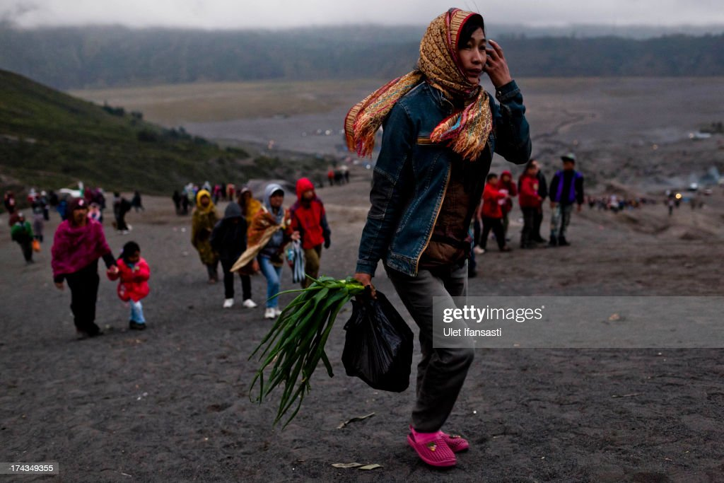 A tenggerese worshipper carry vegetables for an offering during the Yadnya Kasada Festival at crater of Mount Bromo on July 24, 2013 in Probolinggo, East Java, Indonesia. The festival is the main festival of the Tenggerese people and lasts about a month. On the fourteenth day, the Tenggerese make the journey to Mount Bromo to make offerings of rice, fruits, vegetables, flowers and livestock to the mountain gods by throwing them into the volcano's caldera. The origin of the festival lies in the 15th century when a princess named Roro Anteng started the principality of Tengger with her husband Joko Seger, and the childless couple asked the mountain Gods for help in bearing children. The legend says the Gods granted them 24 children but on the provision that the 25th must be tossed into the volcano in sacrifice. The 25th child, Kesuma, was finally sacrificed in this way after initial refusal, and the tradition of throwing sacrifices into the caldera to appease the mountain Gods continues today.