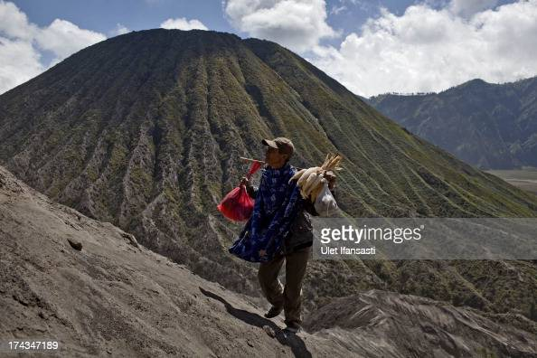Tenggerese worshipper climbs the mount Bromo during the Yadnya Kasada Festival at crater of Mount Bromo on July 23 2013 in Probolinggo East Java...