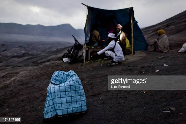 Tenggerese worshipper covers his body with sarong at the foot of Mount Bromo during the Yadnya Kasada Festival at crater of Mount Bromo on July 24...