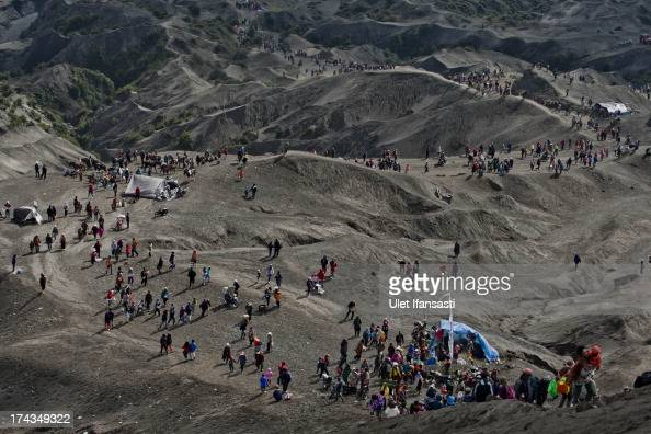 Tenggerese worshippers trek across 'Sea of Sand' to give their offerings to Mount Bromo during the Yadnya Kasada Festival at crater of Mount Bromo on...
