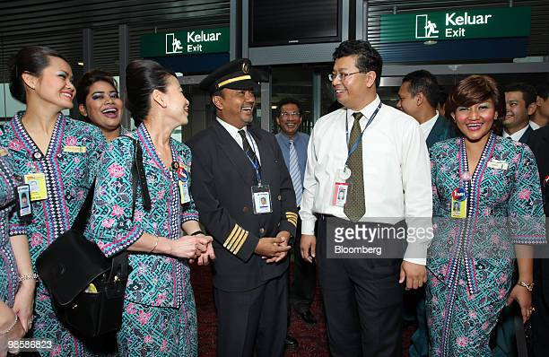 Tengku Azmil Zahruddin chief executive officer of Malaysian Airline System Bhd center welcomes cabin staff off Malaysia Airlines flight MH001s from...