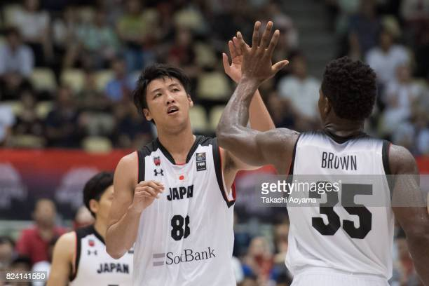 Tenketsu Harimoto and Ira Brown of Japan celebrate a score during the Men's Basketball international match between Japan and Uruguay at Aoyama Gakuin...