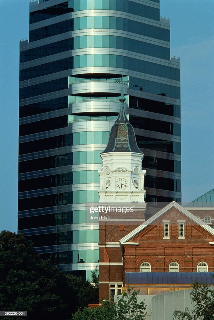 USA, Tennessee, Knoxville, old building in front of modern office : Stock Photo