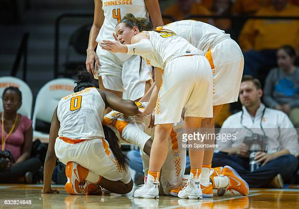 Tennessee Lady Volunteers guard Alexa Middleton motions for a trainer to look at guard Meme Jackson who was injured on a play during a game between...