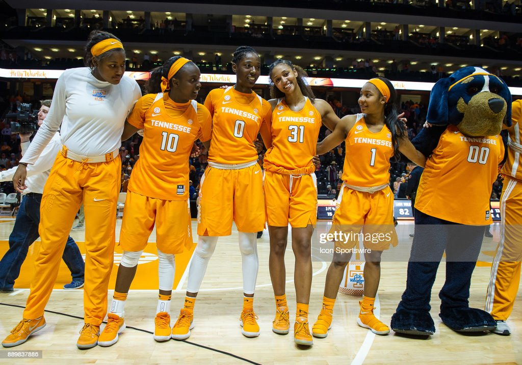 Tennessee Lady Volunteers guard Meme Jackson (10), guard/forward Rennia Davis (0), guard/forward Jaime Nared (31), guard Anastasia Hayes (1) , and Tennessee Volunteers mascot Smokey celebrate after a game between the Texas Longhorns and Tennessee Lady Volunteers on December 10, 2017, at Thompson-Boling Arena in Knoxville, TN. Tennessee defeated Texas 82-75.