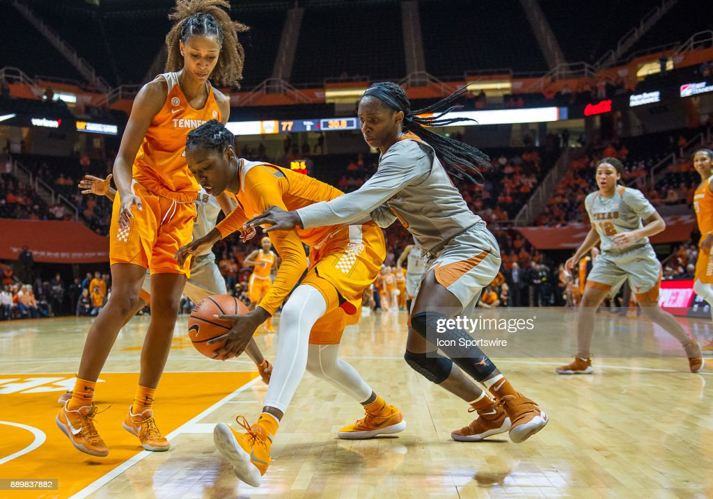 Tennessee Lady Volunteers guard/forward Rennia Davis (0) and Texas Longhorns guard Lashann Higgs (10) go for a ball underneath the basket during a game between the Texas Longhorns and Tennessee Lady Volunteers on December 10, 2017, at Thompson-Boling Arena in Knoxville, TN. Tennessee defeated Texas 82-75.