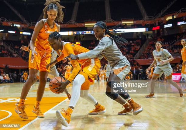 Tennessee Lady Volunteers guard/forward Rennia Davis and Texas Longhorns guard Lashann Higgs go for a ball underneath the basket during a game...