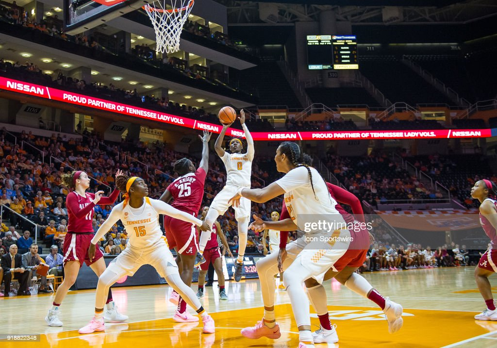 Tennessee Lady Volunteers guard/forward Rennia Davis (0) takes a shot over Alabama Crimson Tide forward Ashley Knight (25) during a game between the Tennessee Lady Volunteers and Alabama Crimson Tide on February 15, 2018, at Thompson-Boling Arena in Knoxville, TN. Alabama defeated the Lady Vols 72-63.