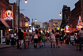 USA, Tennessee, Memphis, people walking on Beale Street at dusk, rear view