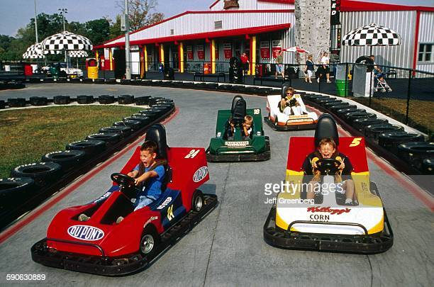 Tennessee Sevierville Kids Driving In GoCarts At The Nascar Speed park In The Great Smoky Mountains