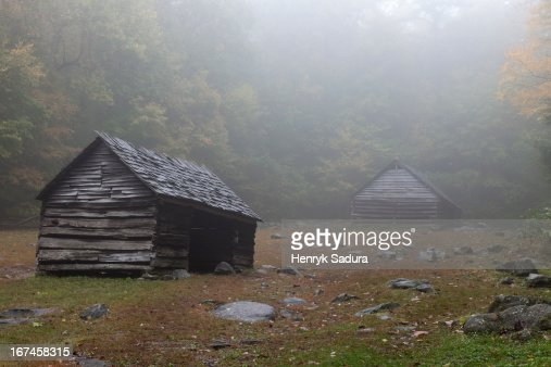 USA, Tennessee, Smoky Mountains National Park, Sheds in foggy glade : Stock Photo