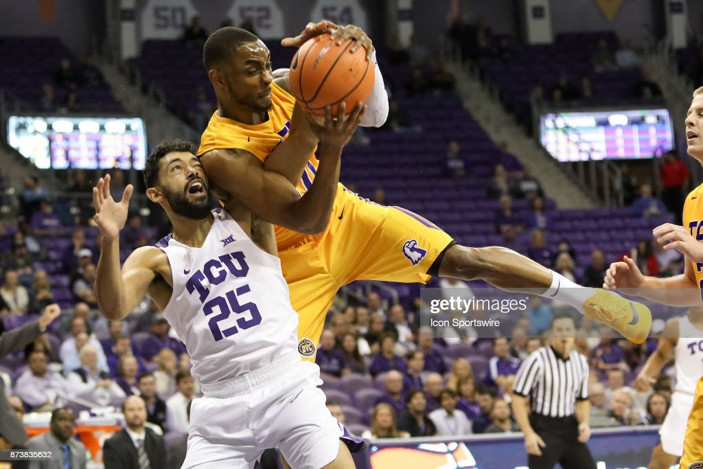 Tennessee Tech Golden Eagles guard Kajon Mack (10) and TCU Horned Frogs guard Alex Robinson (25) battle for a rebound during the game between the Tennessee Tech Golden Eagles and TCU Horned Frogs on November 13, 2017 at Ed & Rae Schollmaier Arena in Fort Worth, TX.