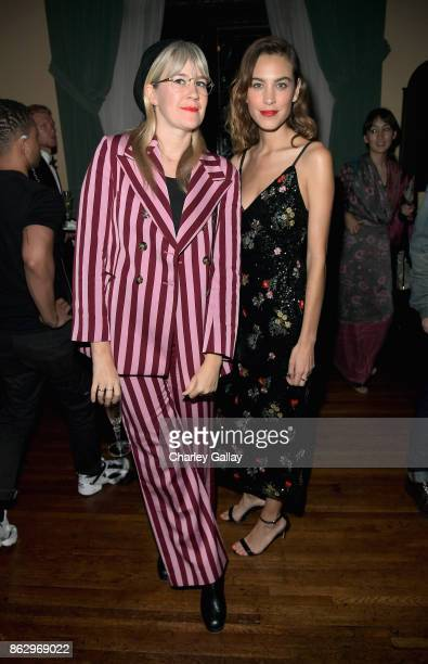 Tennessee Thomas and Alex Chung at HM x ERDEM Runway Show Party at The Ebell Club of Los Angeles on October 18 2017 in Los Angeles California